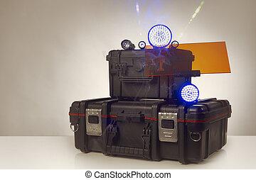 Equipment of police investigator - suitcase, lasers,...