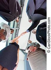 equipo negocio, acogedor, nuevo, socios