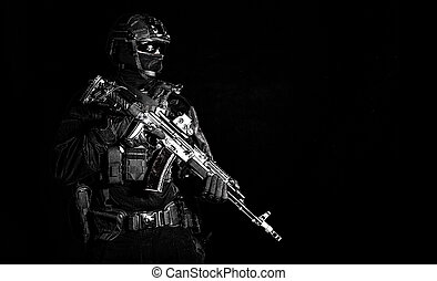 Equipped elite forces soldier low key portrait