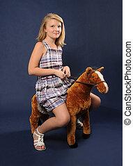 equitación, niña, juguetee caballo