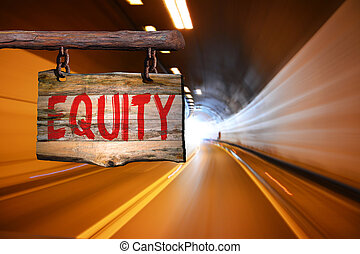 Equity motivational phrase sign on old wood with blurred...
