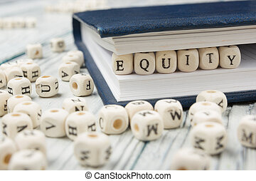 EQUITY word written on wood block. Wooden Abc.