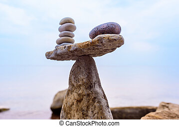 Equivalent weight of stones - Zen-like of stones on the...