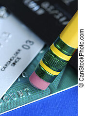Erase the debt on the credit cards isolated on blue