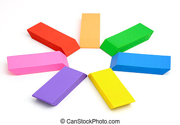 Three colour erasers on a white background