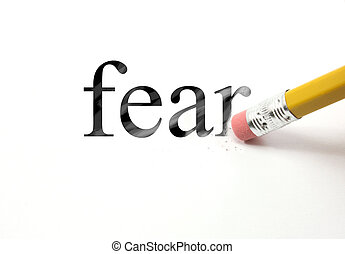 Erasing Fear - The word Fear written with a pencil on white...