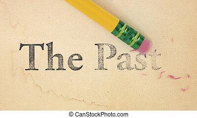 Erasing The Past - Close up of a yellow pencil erasing the...