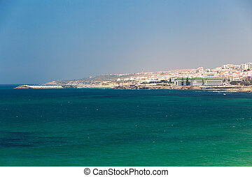 Ericeira city and green sea in Portugal