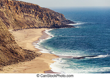 Ericeira green ocean shore and waves in Portugal