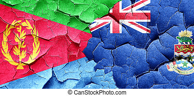 Eritrea flag with Cayman islands flag on a grunge cracked wall