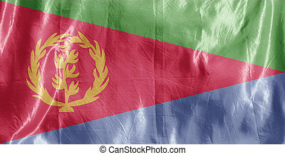 State flag fluttering in the wind. Colored background on textiles