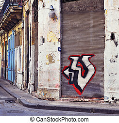 Detail of shabby building exterior with graffiti in Old Havana street