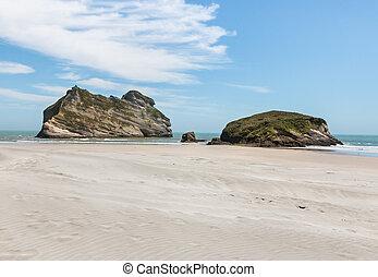 eroded rock formation at Wharariki beach, New Zealand