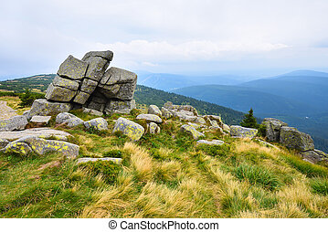 Eroded stones on a peak in the mountains of Krkonose, Czech Republic