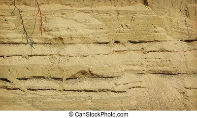 Erosion of sandy soil