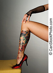 erotic - beautiful leg with beautiful tattoo
