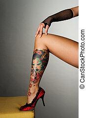 beautiful leg with beautiful tattoo