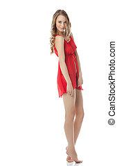 Erotic fashion. Pretty model in red negligee