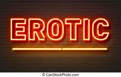 Erotic neon sign on brick wall background.