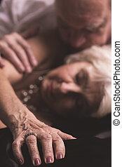 Erotic picture of senior couple