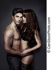 Erotic portrait of a sexy couple - Erotic portrait of an...