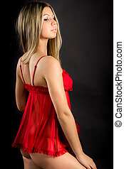 portrait of a young blonde in red lingerie