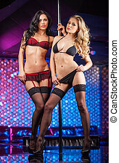 Erotic show from two sexy girls. Passion moves on stage from pole dancers
