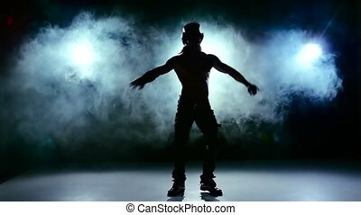 Erotic show of man, continue dance and spin in smoke, on black, slow motion