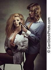 erotic women applying make-up