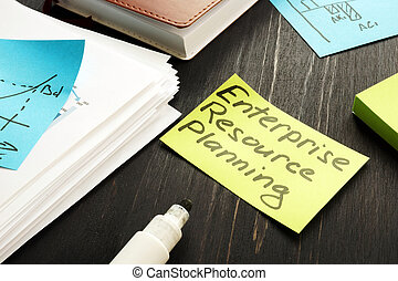 ERP - Enterprise resource planning concept. Stack of business papers.