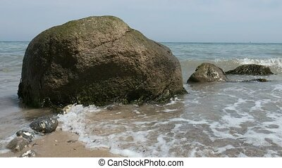Erratic block in the surf with sound - Baltic Sea -...