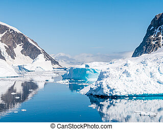 Errera Channel with drifting icebergs and ice floes on a sunny day in antarctic summer, Antarctica