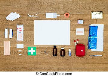 erste-hilfe-ausrüstung, posten, ausgerichtet, auf, hölzern, oberfläche, mit, kopieren platz, bereich