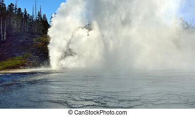 erupting Grand Geyser in Upper Geyser basin of Yellowstone National Park, Wyoming