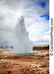 Geysir - Eruption of Geysir - a large geyser in southwestern...