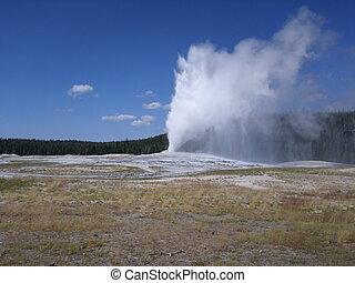 Eruption of Old Faithful geyser at Yellowstone National Park, USA