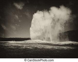 Eruption of Old Faithful Geyser at Yellowstone National Park