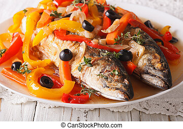 Escabeche fish: mackerel in vegetable marinade close-up....