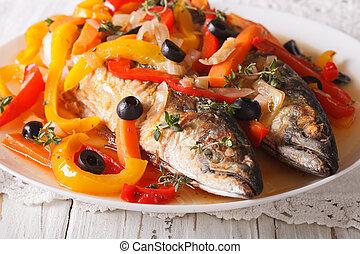 Escabeche fish: mackerel in vegetable marinade close-up....