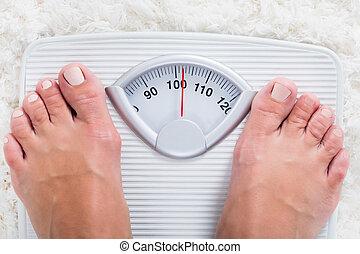 escala que pesa, persona, posición