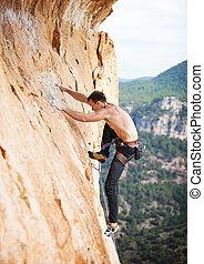 escalador pedra, ligado, um, rosto, de, um, penhasco