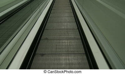 Escalator at shopping mall POV