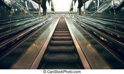 Escalator cloth between reflective walls, upward motion