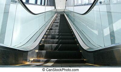 Escalator - Empty modern escalators are shown that...