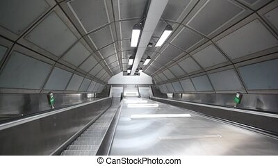 escalator going down with nobody on it in London subway