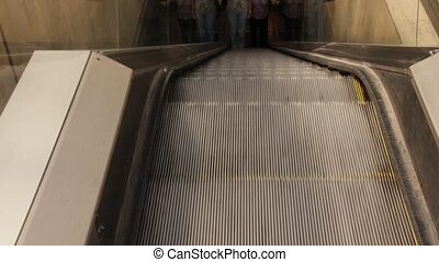 Escalator Going Up with Metal Steps