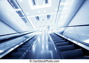 Escalator in modern office building,motion blur