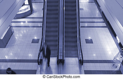 Escalator in shopping center