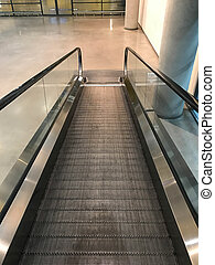 Escalator in shopping mall, moving down