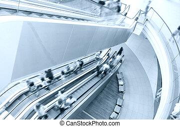 Escalator in shopping mall.